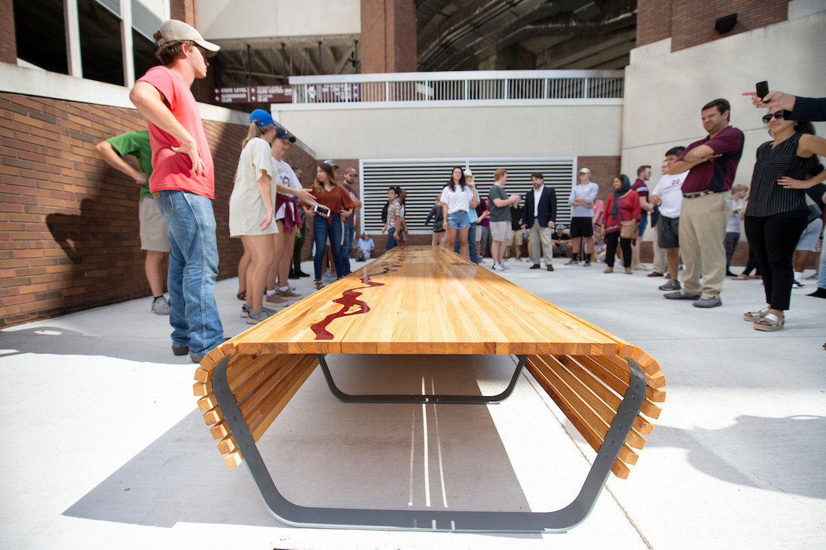 Bulldog-Built Benches Second year architecture and building construction science students are partnering with MSU Athletics to design and build benches that will be placed in four athletic venues. Pictured is a bench that students designed and built that was placed near Gate F of Davis Wade Stadium.  Photo by: Megan Bean  October 9, 2018