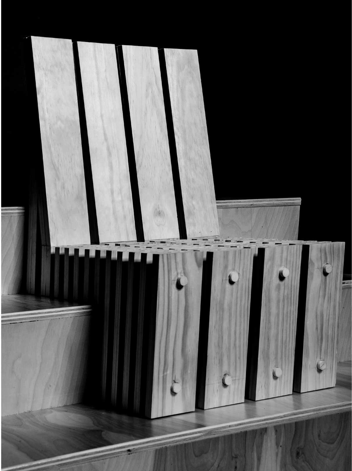 Olivia Baker and Krishna Desai: A Chair for Listening. Shows black and white image of wooden chair design.