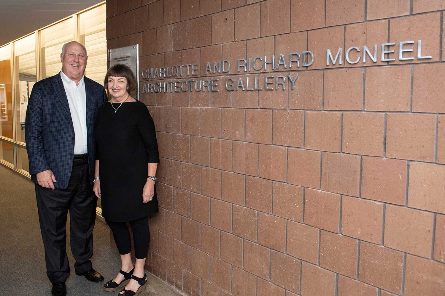 pictured outside of gallery in Giles Hall, left to right, Richard McNeel and Charlotte McNeel