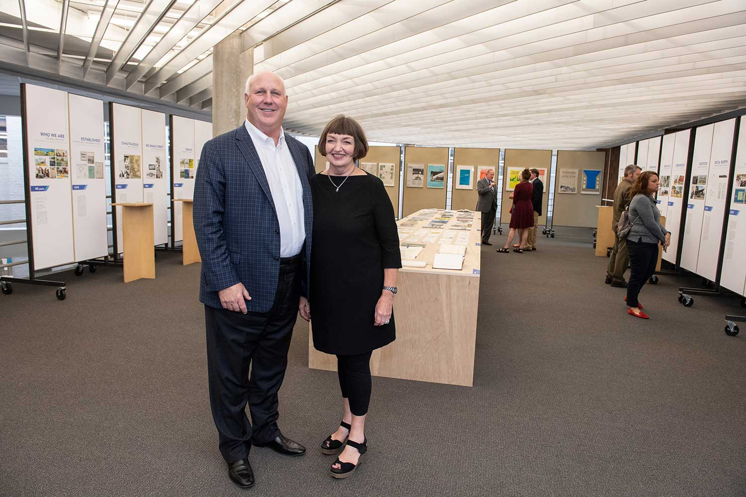 pictured inside of gallery in Giles Hall, left to right, Richard McNeel and Charlotte McNeel