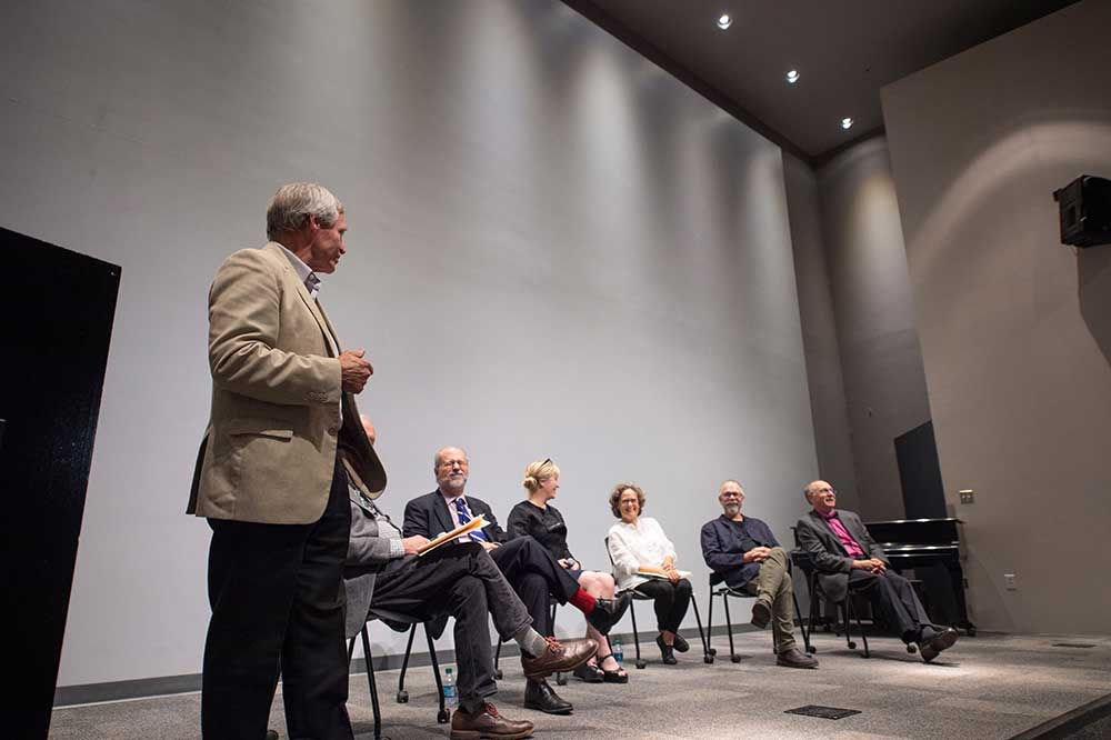 Former CAAD Dean Jim West, standing, introduces a panel of former faculty and administrators of the university's Fred Carl Jr. Small Town Center. Panelists (seated, l-r) include John McRae, John Poros, Kimberly Brown, Shannon Criss, Nils Gore, and Michael Buono.