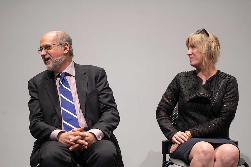 seated: left to right: John Poros and Kimberly Brown
