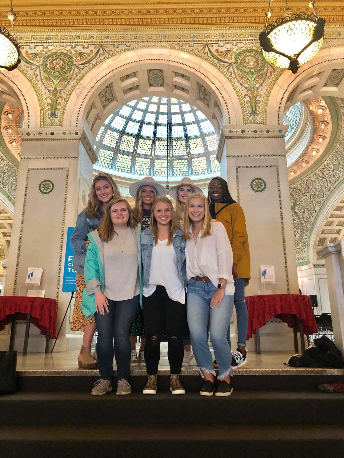 a group of students pose inside iconic building in Chicago