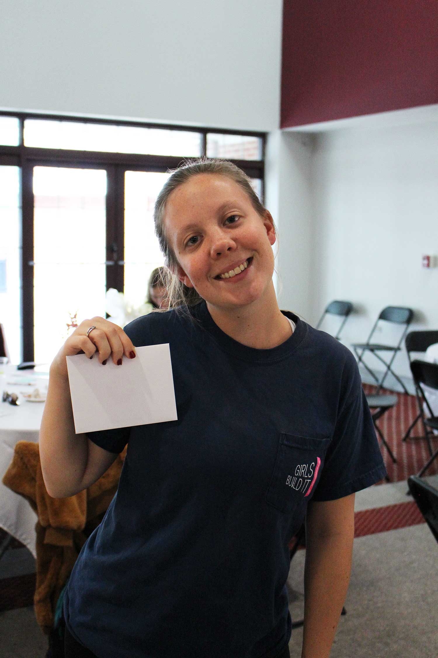 Jalyn Wallin smiles with gift card envelope in hand