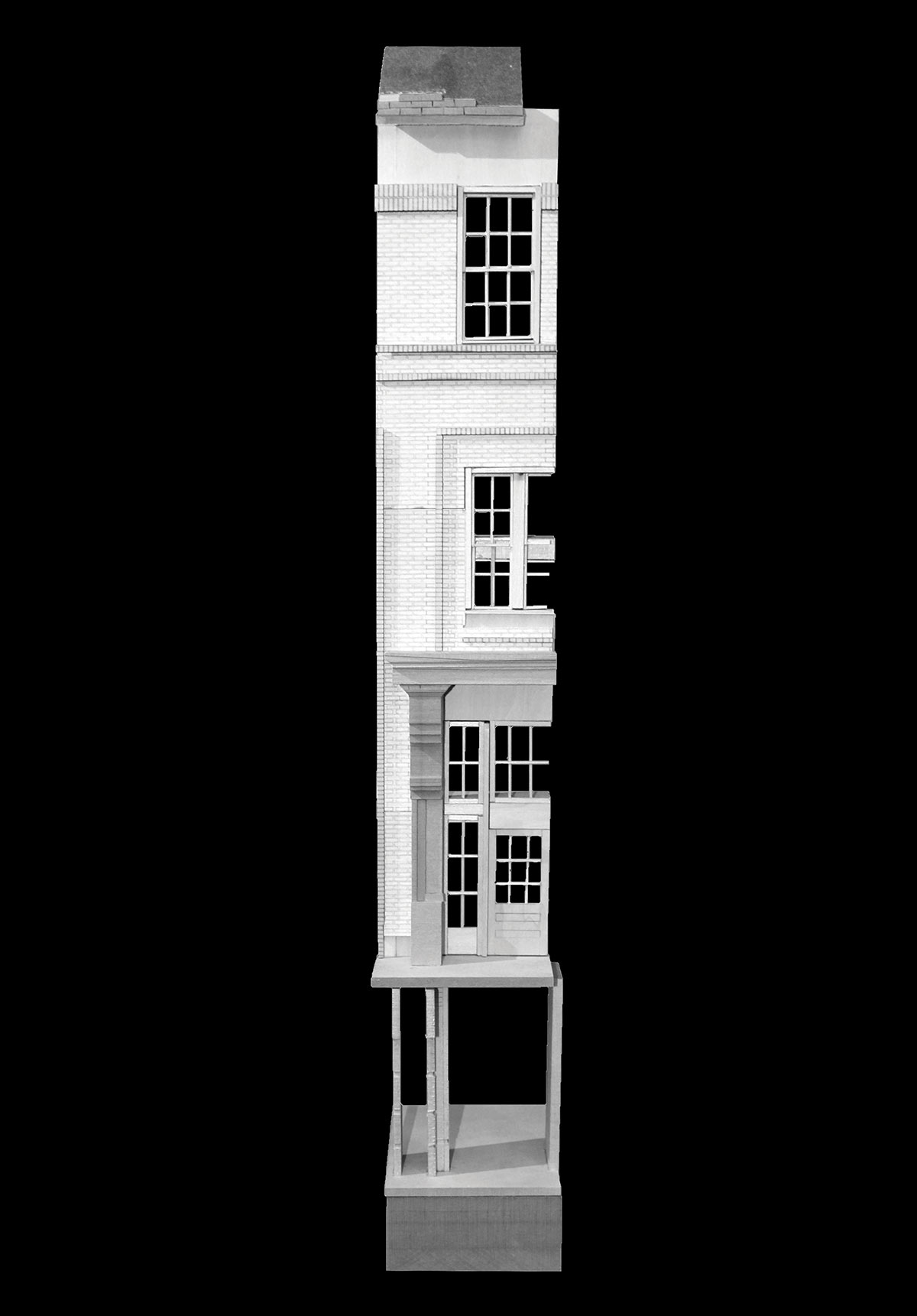 black and white image of vertical section of a 3-story building