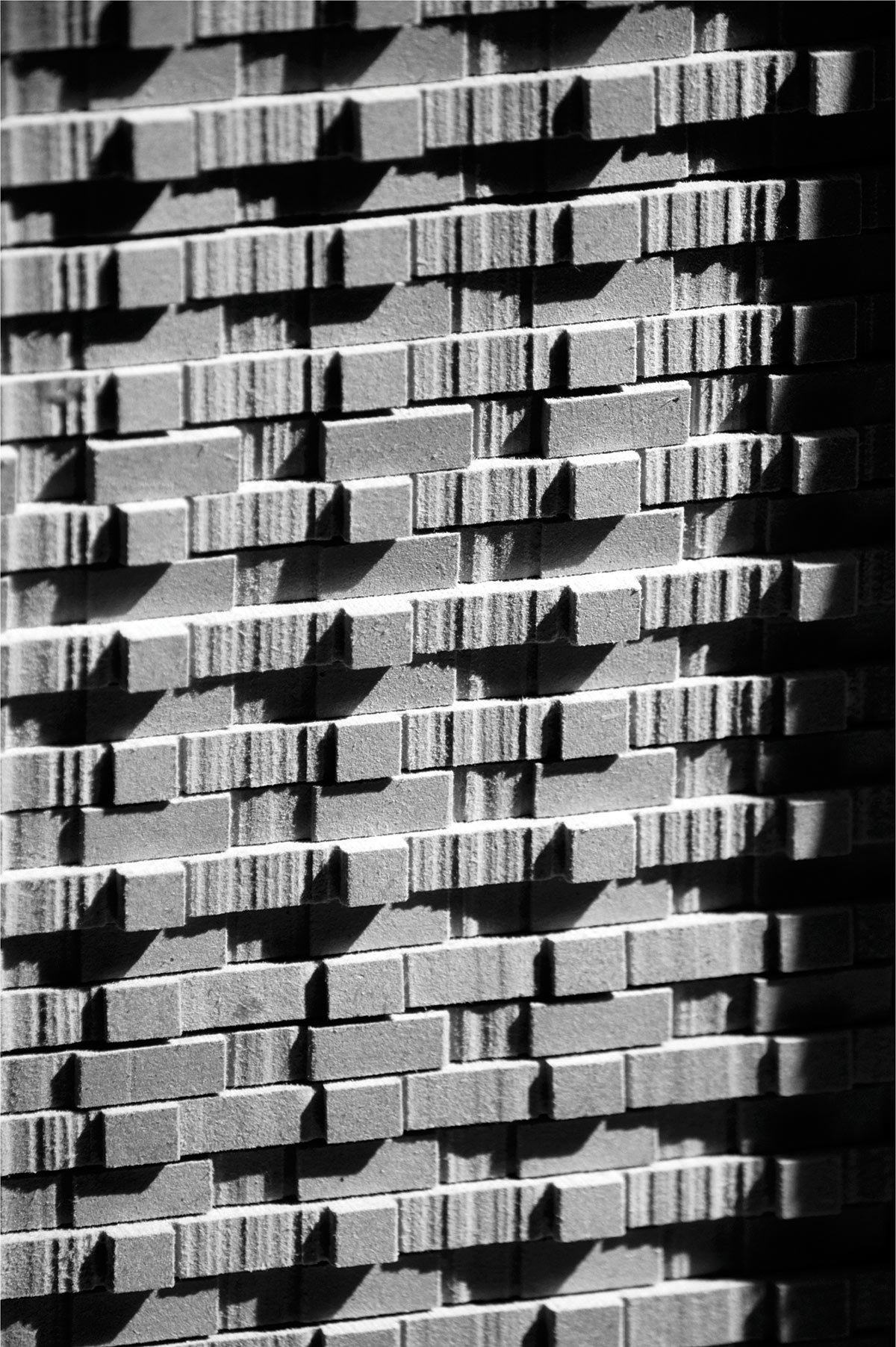 black and white image of a building facade - possibly brick