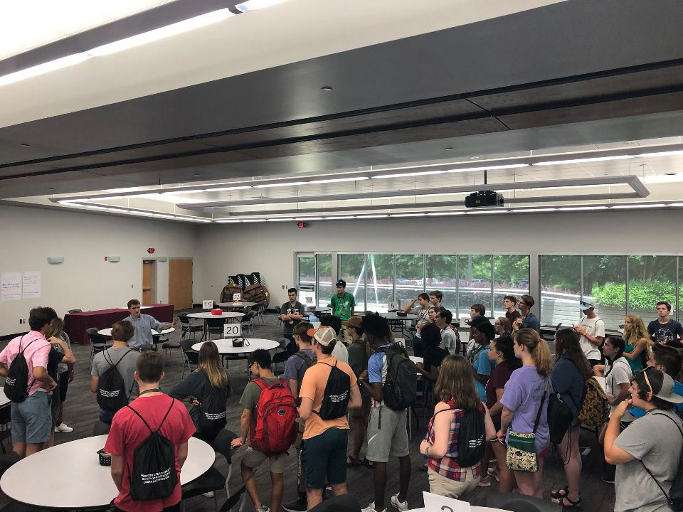 the campers listen to a speaker during a tour of the Hunter Henry Center on campus