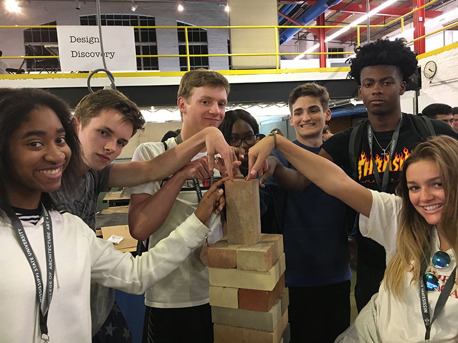 campers show off their tower built with bricks