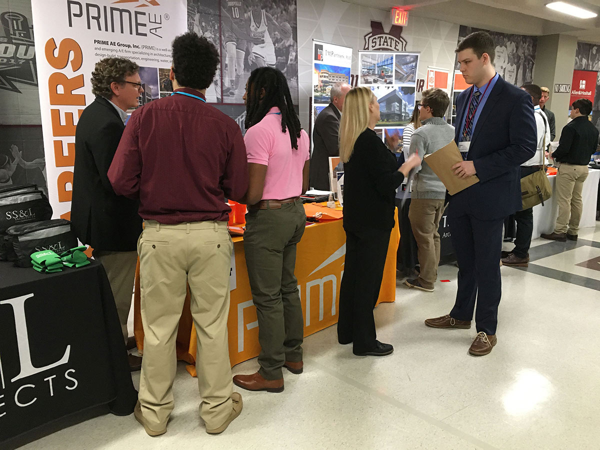 architecture students talk with potential employers at the MSU Career Expo