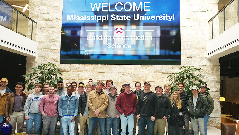 Mississippi State building construction science first-year students pose in the lobby of Brasfield and Gorrie's Atlanta office.