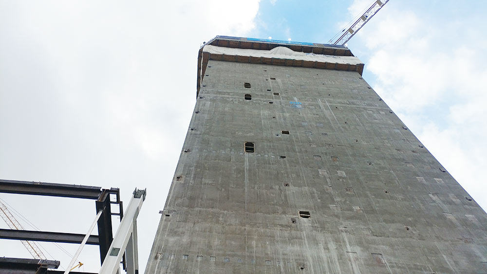 view from the bottom of a concrete elevator shaft being built