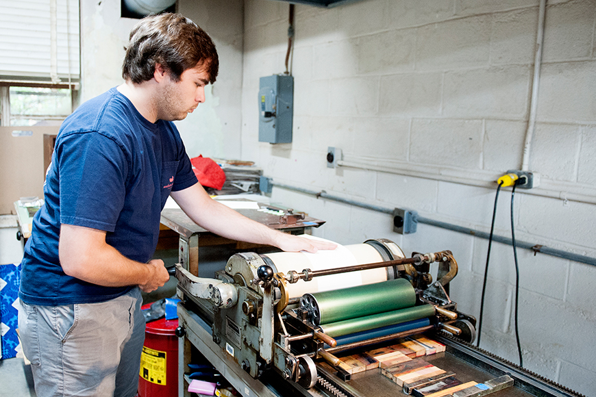 "Mississippi State senior art/graphic design major Mitchell S. ""Mitch"" Phillips of Brandon works on a letterpress project in Assistant Professor Suzanne Powney's printing class."
