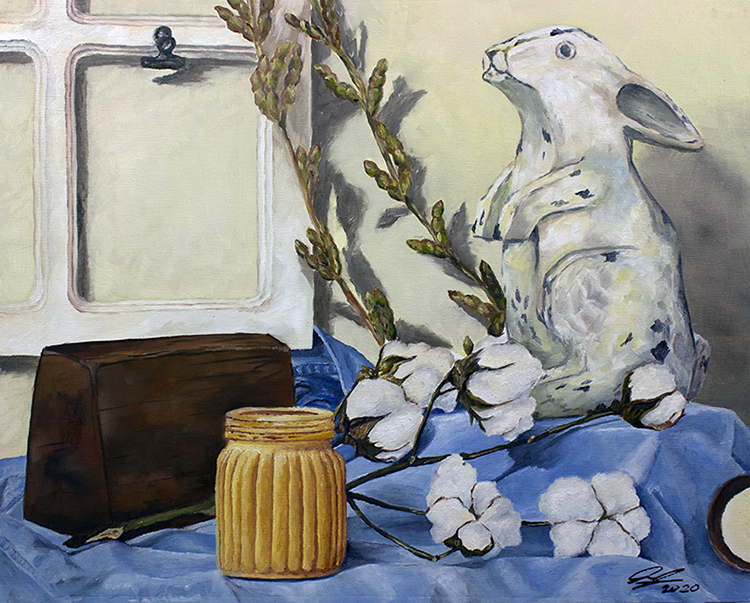 Painting of a still ife with cotton plant, mug, and white rabbit on a blue cloth.