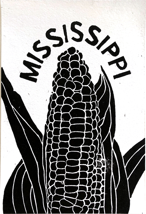 "Black and white image of corn on the cob with the word ""Mississippi"" arched over the top."