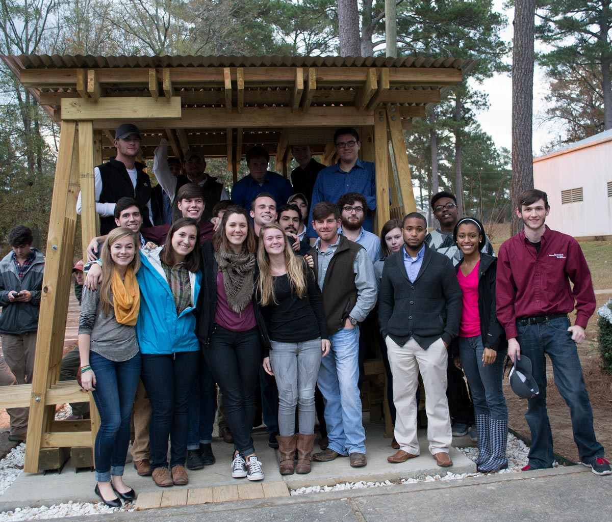 Group shot of students in front of completed structure.