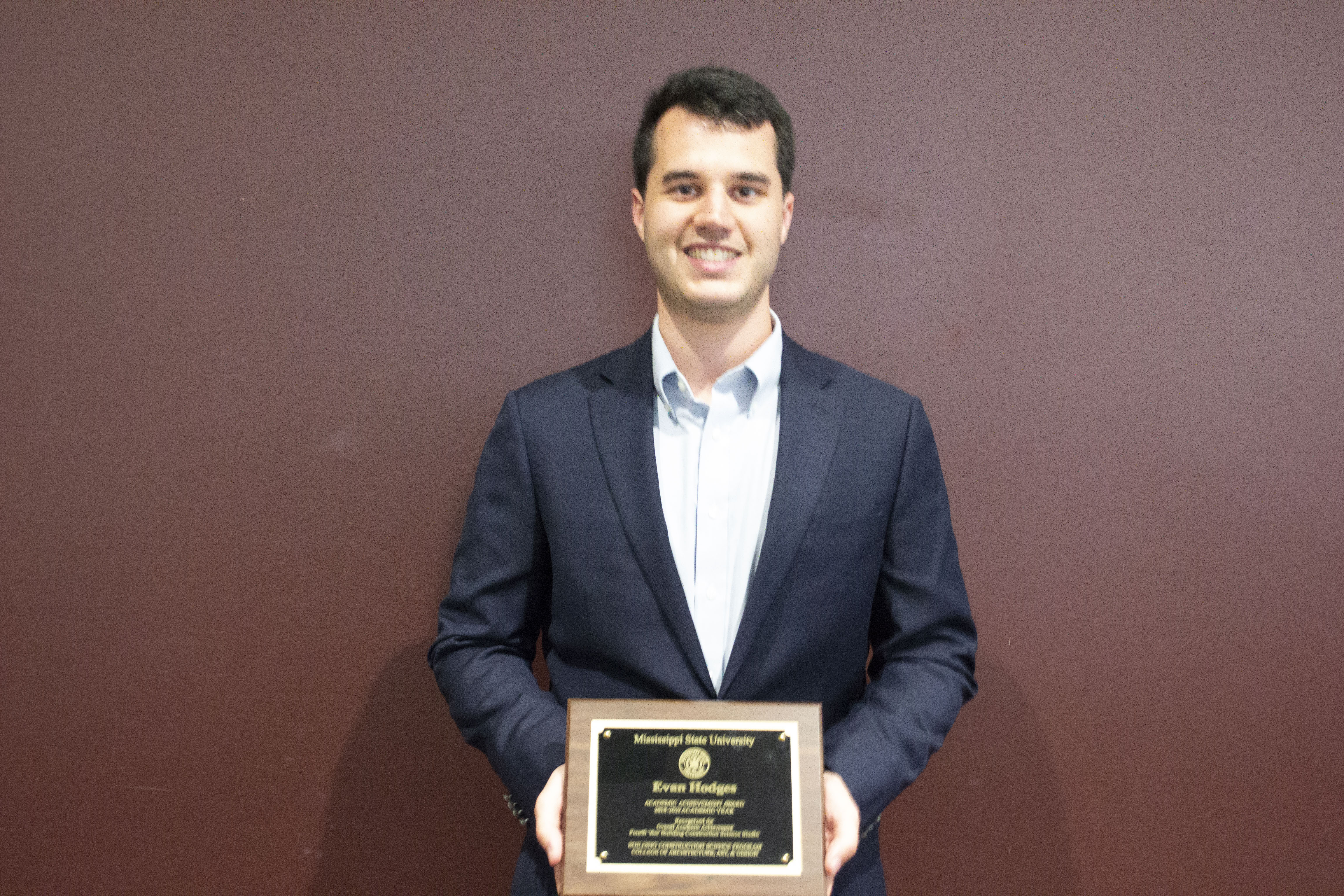 Evan Hodges with his fourth-year Mississippi State University Building Construction Science Student of the Year Award