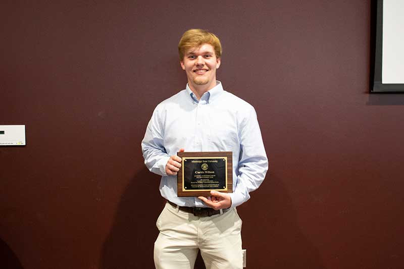 Curtis Wilson with his second-year Mississippi State University Building Construction Science Student of the Year Award