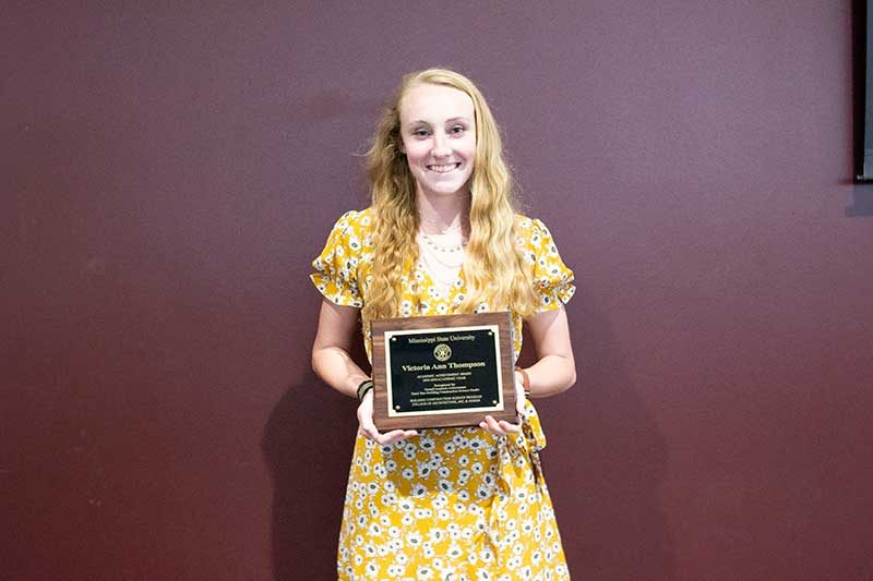 Victoria Thompson with her third-year Mississippi State University Building Construction Science Student of the Year Award