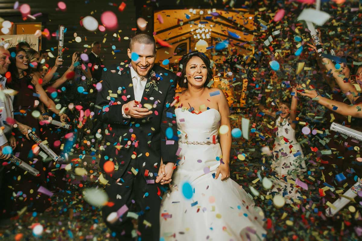Wedding photo of bride and groom with confetti
