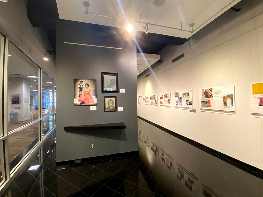view of wall of art in gallery