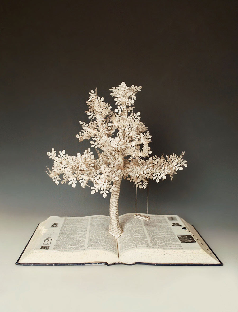 Hanna Bewley's artwork - book with tree coming out of center made out of what looks like paper from the book