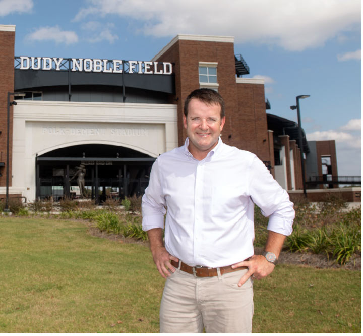 Michael Boerner poses in front of the Dudy Noble field entrance
