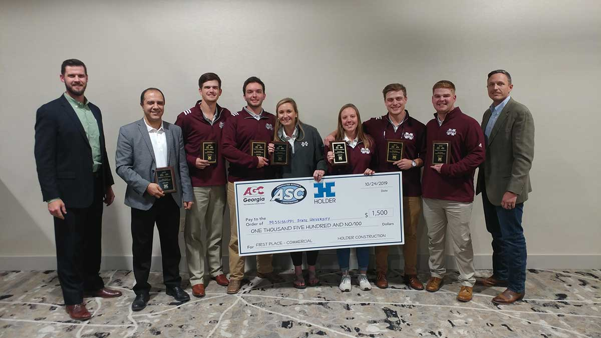 Pictured left to right are Raleigh Flowers, a representative from sponsor Holder Construction; MSU Assistant Professor Saeed Rokooei; Jake Roberson of Brookhaven; Hunter Henderson of Brandon; Kacie Lynn James of Grenada; Jalyn Wallin of Double Springs, Alabama; Steve Dragoo of West Point; Noah Heflin of Macon; and Steven Hunter with Holder Construction.